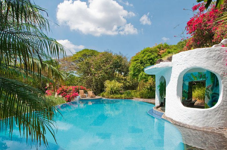 <b>Costa Rica has sloths, waterfalls, volcanos, and absolutely incredible resorts.</b> BRB, going to an airport!
