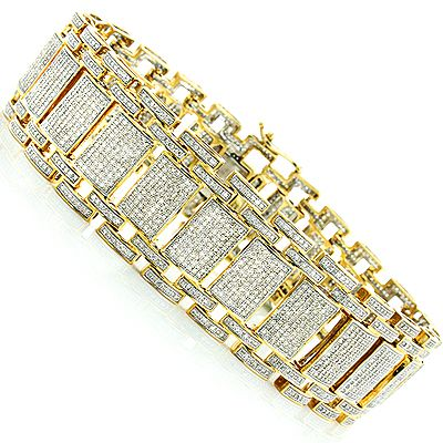 Affordable Iced Out Bracelets! This dazzling Gold Mens Pave Diamond Bracelet from our designer diamond jewelry collection weighs approximately 83 grams in 14K gold (73 grams in 10K gold) and showcases 9.75 ctw of sparkling round diamonds. Featuring an exquisite flexible link design and a fully iced out look, this luxurious mens diamond bracelet is available in your choice of 14 Karat or 10 Karat white, yellow, and rose gold.