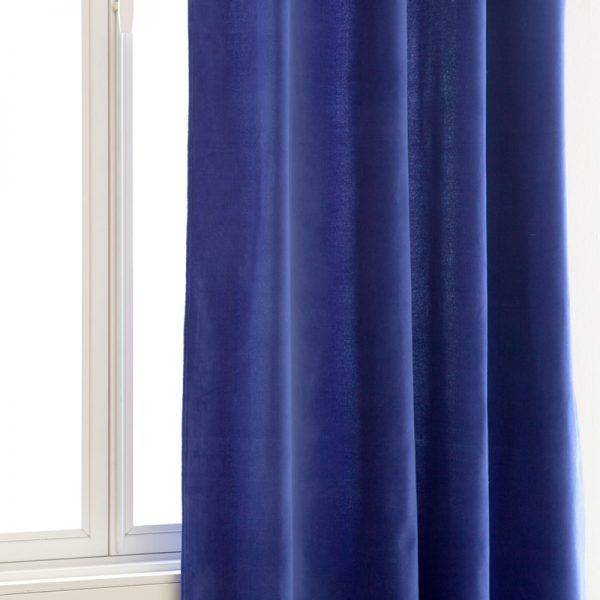 """Mr. Kate - """"Adding a jewel-tone accent color to a space can really change the mood,"""" says Kate Albrecht of Mr. Kate. """"I love these rich blue velvet curtains as a way to bring in a luxurious textile and color to a bedroom. Add one blue throw pillow on your otherwise neutral bed or couch and you've got a whole new look for very little money!""""Blue Velvet Curtain, Zara Home $90"""