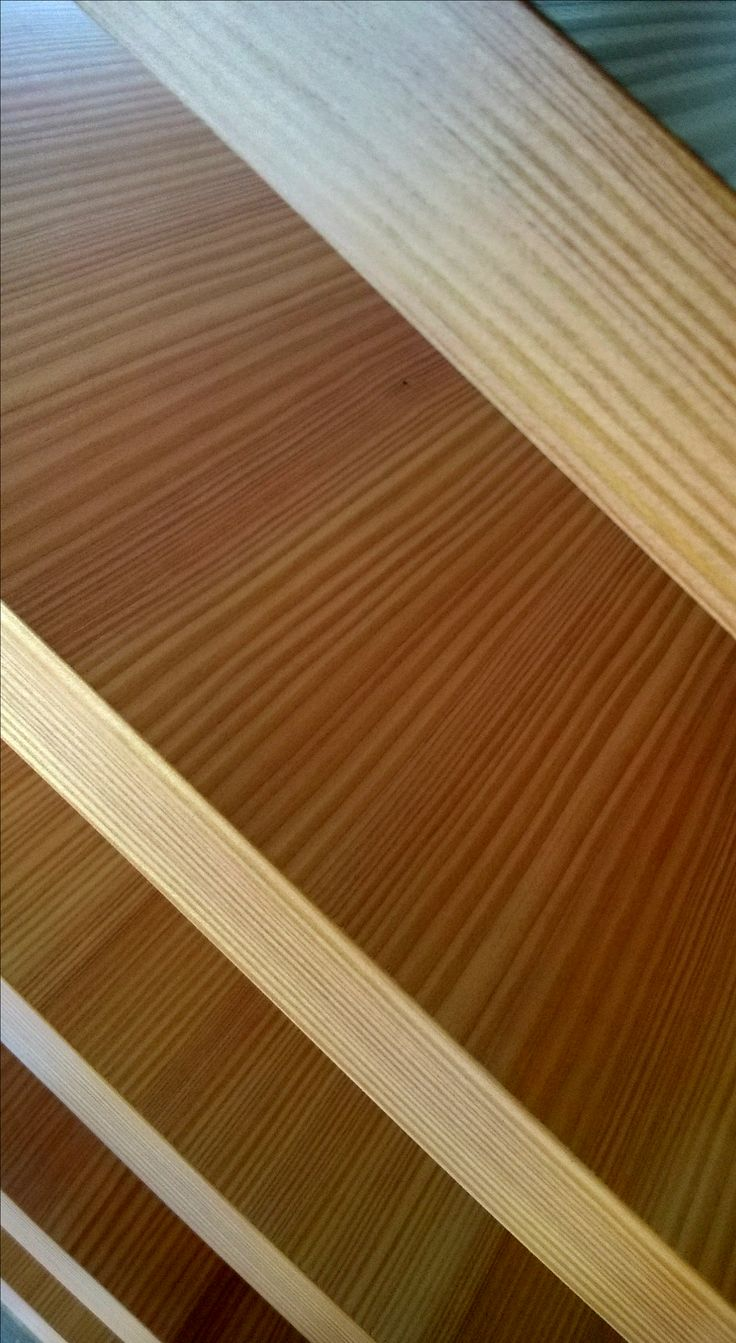 Red pine veneered doorpanels are ready for final finishing layer