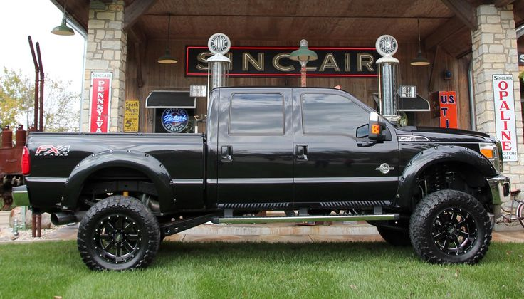 Truck yeah! The finished 2012 Ford F250 crew cab short bed. A lift kit, wheels and tires and under hood modifications took this truck from stock to super cool in less that 4 days. Photo courtesy Truck Paradise/Skip Peterson for Wheels Discount Wheels and Rims #Discount #CarRims www.wheelhero.com