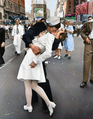Photo colorization by Sanna Dullaway / Original image by Alfred Eisenstaedt—Time Pictures/Getty Images ~   A jubilant American sailor clutching a pretty white-uniformed nurse in a joyful, back-bending, passionate kiss while thousands jam the Times Square area to celebrate the long awaited victory over Japan.