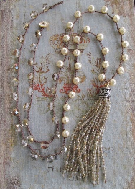 "Pearl tassel necklace Posh Bohemian neutral cream by slashKnots- A sparkly long glass tassel swings from a crocheted chain of Czech glass pearls and glass. Love the movement and shine :) Perfect year round neutral layering necklace! Measures 34"" with a 4 1/2"" tassel drop. Loop closure with an abalone button. BeadTassel"