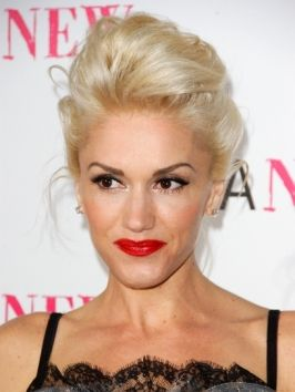 Crown height and an ultra-sleek finish take Gwen Stefani's voluminous hairstyle to a serious party 'do! Pack roots with body with teasing, then direct hair to fall right around the back of the head...
