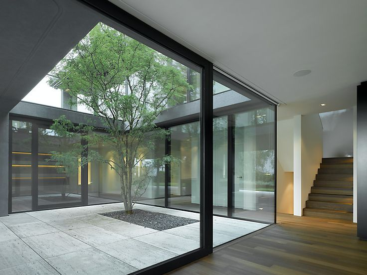 Wild b r heule architekten rebwiesstrasse haus zollikon for Residential atrium