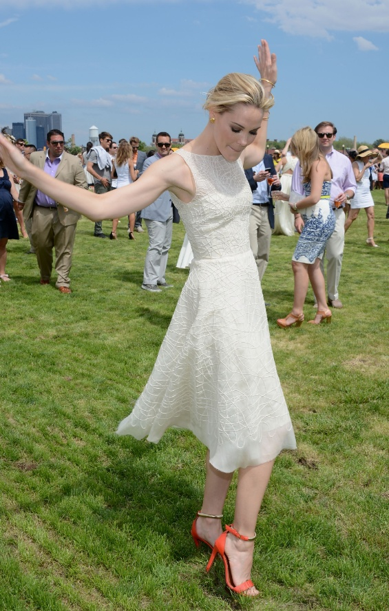 stomping divets  http://static4.businessinsider.com/image/4fcd0a3eeab8eaca5a000009-590/while-actress-leslie-bibb-went-on-the-field-with-the-rest-of-the-spectators-to-stomp-the-divots-a-long-standing-polo-tradition-during-half-time.jpg