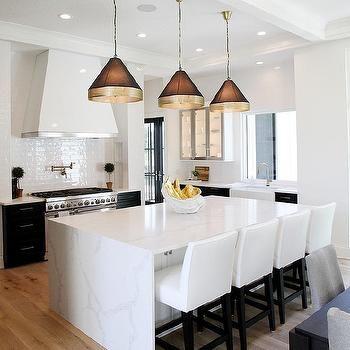 calcutta quartz waterfall island with white upholstered stools kitchen decor apartment on kitchen island ideas white quartz id=35774