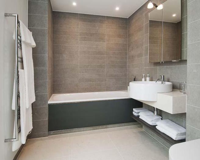 photo of modern beige white bathroom with bath modern lighting