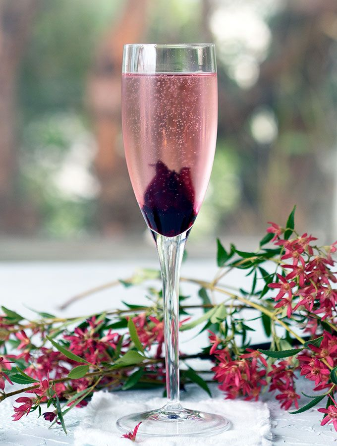 Champagne Cocktail With Hibiscus Flower Champagne Recipes Cocktails Champagne Drinks Champagne Cocktail