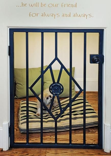 making the space under your stairs as a gated kennel for your dog