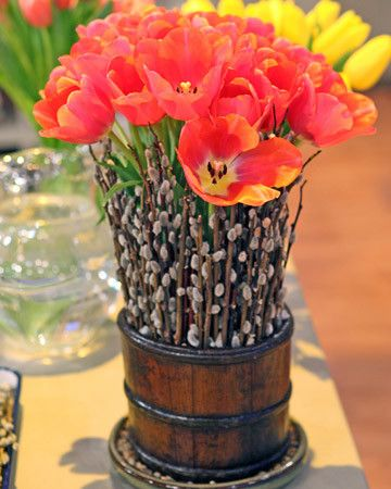 Give tulips, the quintessential spring flower, a more woodland look with this charming table arrangement.