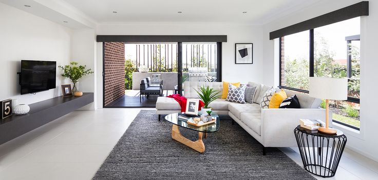 LIVING: Uncluttered and minimalistic design is the basis of any contemporary style. Natural fabrics and monochrome colour palette define this very simple yet modern living space. Visit our Graphix Lookbook style here: http://www.metricon.com.au/get-inspired/lookbook/graphix