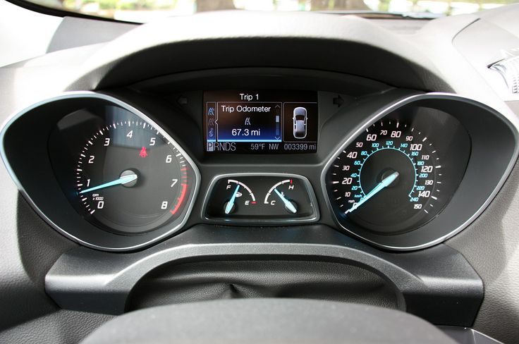 2013 Ford Escape. Odd shaped pods, tiny cheaplooking fuel