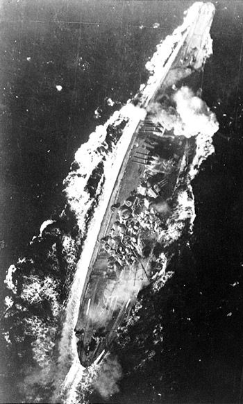 Japanese Battleship Yamato, ablaze from stem to stern, with bombs blasting her forward turret, during the furious 3-day engagement in the Philippines, end of Oct. 1944. Yamato and her sister ship, Musashi, were the heaviest and most powerfully armed battleships ever constructed, armed with nine 46 cm ( 18.1 inch) 45 Caliber Type 94 main guns. Yamato was sunk in April 1945 by American bombers, with loss of most of her crew.