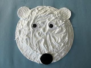Polar bear made of a paper plate covered with a mix of shaving cream and white glue. The nose is an Oreo cookie. It could be made with frosting or meringue instead!