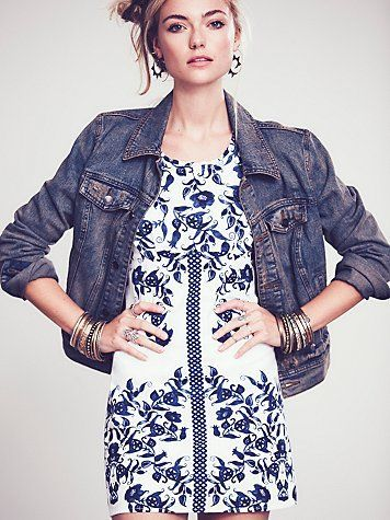 Denim jacket over printed body con dress