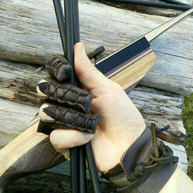 Customer shared photo, showing our archery glove in action!  Made and sold by folkofthewood on etsy