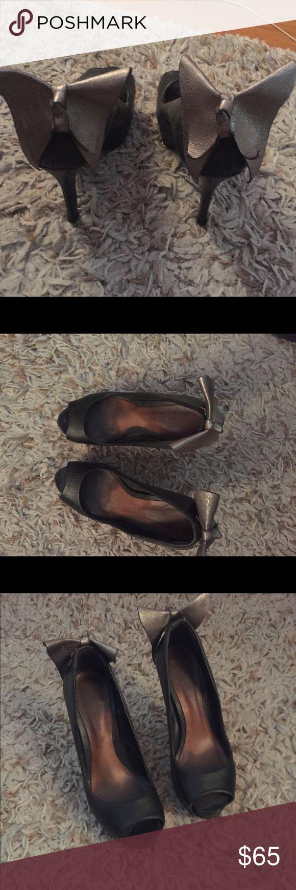 Black peep toe pumps Black peep toe Aldo pumps with silver bow detail on the back. Aldo Shoes Heels