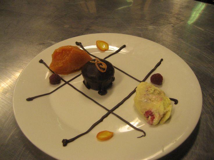 Chocolate Stout Cake, with hawthorne sorbet, & raspberry lambic ice cream.