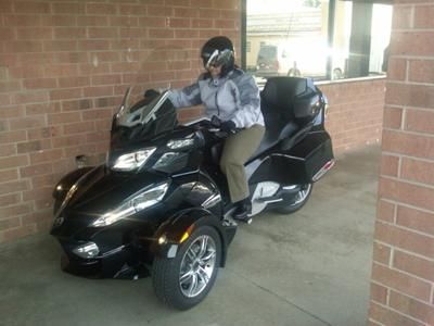 2010 Can Am Spyder: This my own transformer he is sleek and he is comfortable! Spyder Can Am 2010 tourister...wowsa!! After years of wanting too..I broke down and did it..became