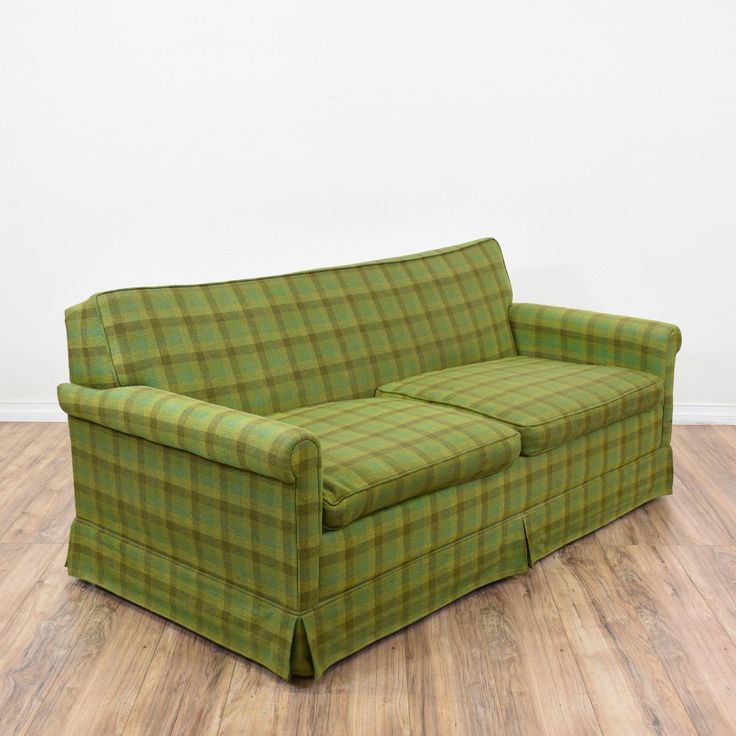 This sleeper sofa is upholstered in a durable green plaid upholstery with light lime green and moss green accents. This sofa bed is in good condition with a pull out mattress, curved arms and a low back. Great for a guest bedroom! #traditional #sofas #sofabed #sandiegovintage #vintagefurniture