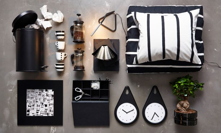 Display of a black pedal bin, white/black mugs, striped quilt cover set, wall clocks, a black cardboard box with compartments and a coffee/tea maker, all from IKEA.