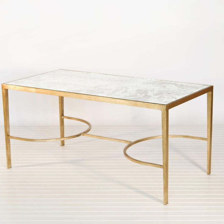 Superb Gold Leafed Mirrored Sabre Leg Coffee Table By Worlds Away