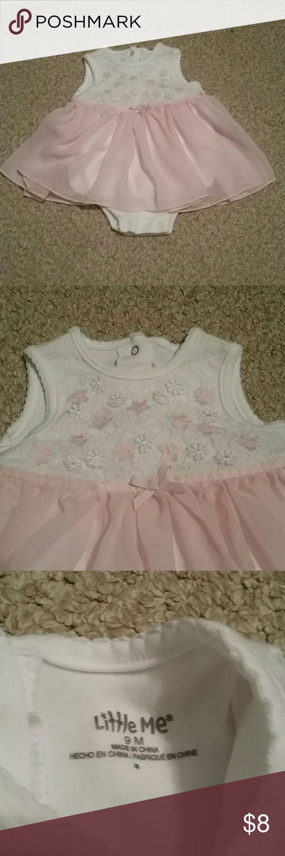 Precious pink and white dress White dress with light pink sheer skirt.  Onesie underneath.  Three snaps on the back.  Front has white lace with white and light pink flowers and a pink bow at the waist.  Excellent condition... only worn once for a tea party.  Runs a little small.  So precious! Little Me Dresses