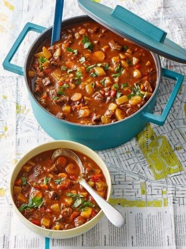 Goulash Soup (Gulaschsuppe). 1 lb (450 g) stewing beef, cut into ¾-inch cubes 2 tbsp oil 2 onions, coarsely diced 1 garlic clove, crushed 1½ cups tomato juice 1 cup beef broth (feel free to substitute with 1 cup red wine) 1 tsp salt 1 tbsp sweet Hungarian paprika 2 – 3 potatoes, cut into 1-inch cubes 3 peppers, preferably different colors, cut into 1-inch pieces salt, pepper, hot Hungarian paprika (optional)