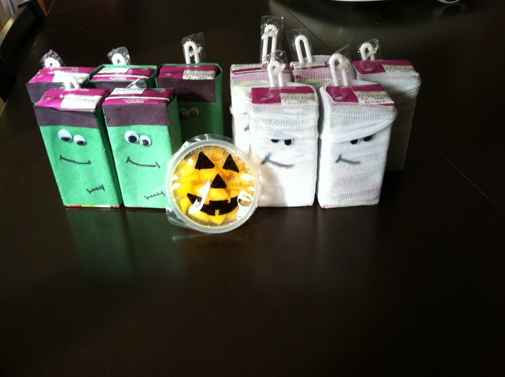 Monster juice boxes and Jack-o-Lantern fruit cups.  Construction paper and googly eyes for Frankenstein.  Gauze and googly eyes for the mummies.  Simple, reduced sugar, and extremely festive for those Halloween parties with kiddos. Great Preschool snack. :)