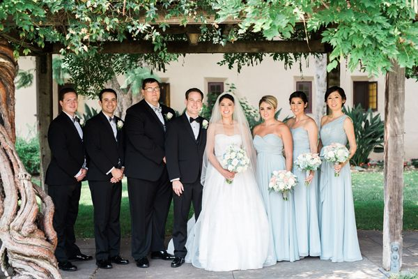 Classic light blue bridesmaid dresses and black tuxes for a Disney themed wedding | Elegant Disney Wedding at Four Seasons Hotel Silicon Valley | Annie Hall Photography | See more on My Hotel Wedding: https://www.myhotelwedding.com/blog/2016/04/11/elegant-disney-wedding-at-four-seasons-hotel-silicon-valley/
