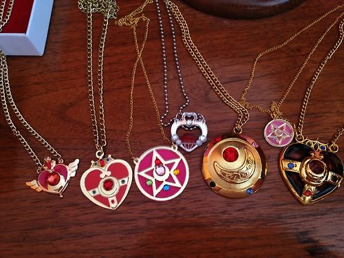 All of my lovely Sailor Moon necklaces! <33 Where to buy them: Garnet Orb and Crystal Stars Transformation Brooch Crisis Moon Compact(or...