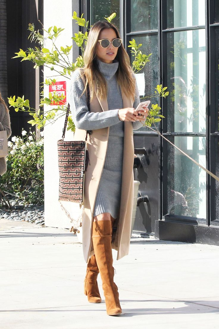 Jamie Chung was seen shopping at Melrose Place in Los Angeles wearing a grey turtleneck dress, cognac brown knee-high boots, and a camel vest.    The style pro finished her look with retro-inspired ...