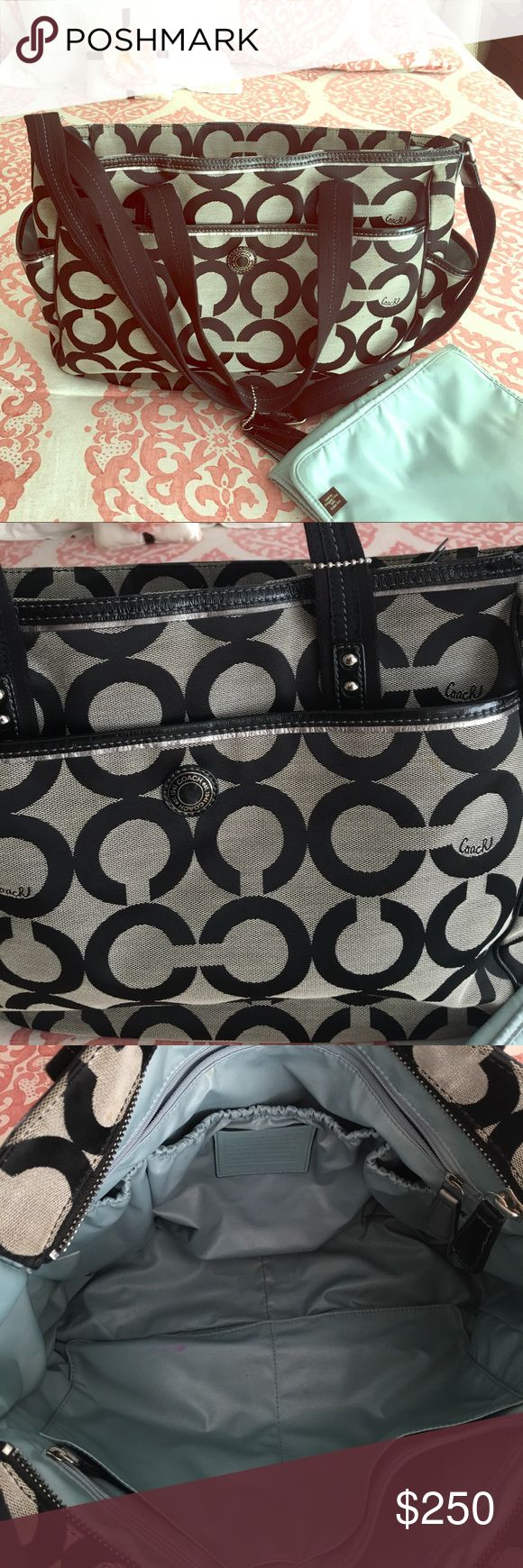 Coach diaper bag Signature monogram coach diaper bag in black. Has a baby blue interior. Comes with changing pad. This bag is in pretty great condition. There are some small stains on the inside minor minor ones on the outside as pictured. Otherwise it looks like new! If making an offer please keep in mind that posh does keep 20%. Thank you! Coach Bags Baby Bags