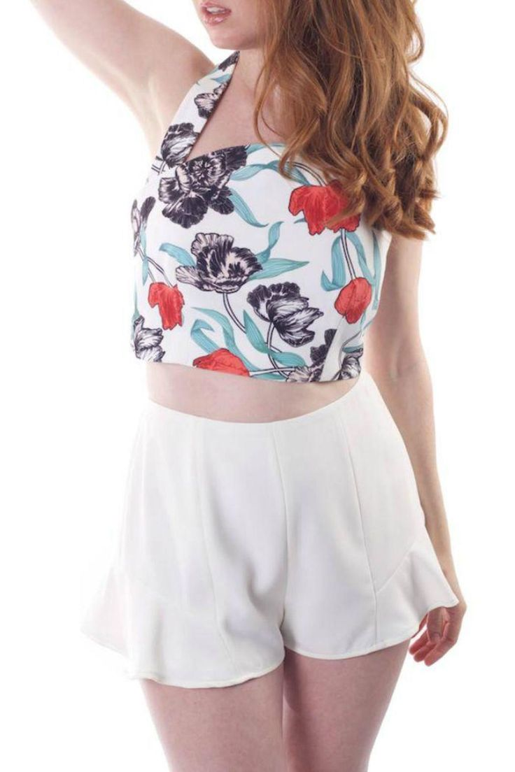 The 'These Days' top by Cameo is a halter neck cropped top that features a red peony print, an exposed back and back zip. Pair it up with a pair of white, dressy shorts.   These Days Top by Cameo . Clothing - Tops - Crop Tops Miami, Florida