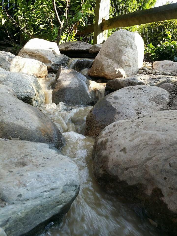 Backyard waterfall installed by Across the Pond Aquascapes. #pond #waterfall #backyard #landscaping #garden #buckscounty