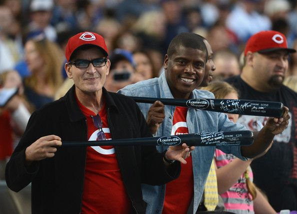Charlie Sheen and Tony Todd Photos Photos - Actor Charlie Sheen and Tony Todd pose with bats during the game between the Cincinnati Reds and the Los Angeles Dodgers at Dodger Stadium on July 4, 2012 in Los Angeles, California. - Cincinnati Reds v Los Angeles Dodgers