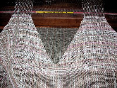fascinating technique, could be used with a variety of our looms! How to Weave a V neckline on the loom.