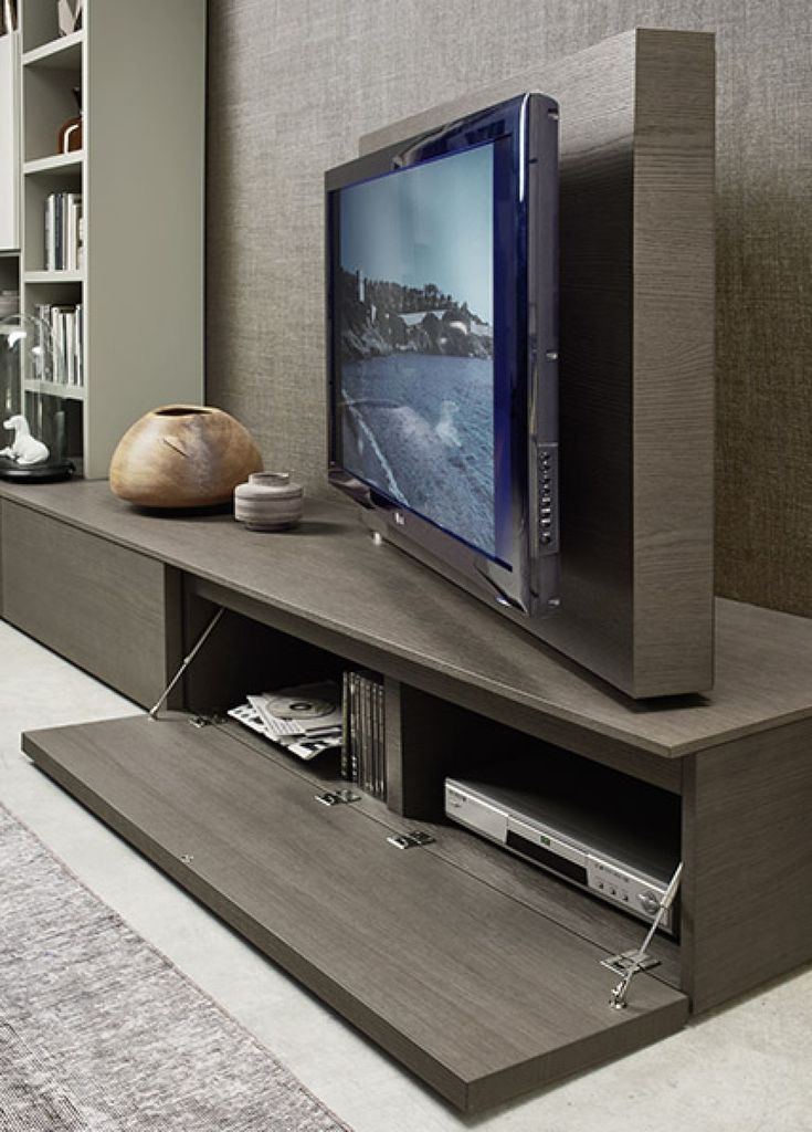 This swivel TV feature with hidden media storage on the Kronos S28 is ideal for all living spaces for a minimalist design. Available from IQ Furniture.