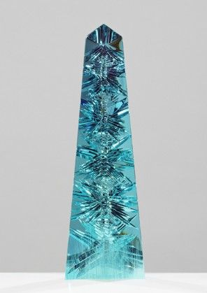 The largest Aquamarine in the world, called Dom Pedro, is 14 inches tall and weighs 10,363 carats. That's the heft of a barbell, nearly five pounds. / Smithsonian National Museum.