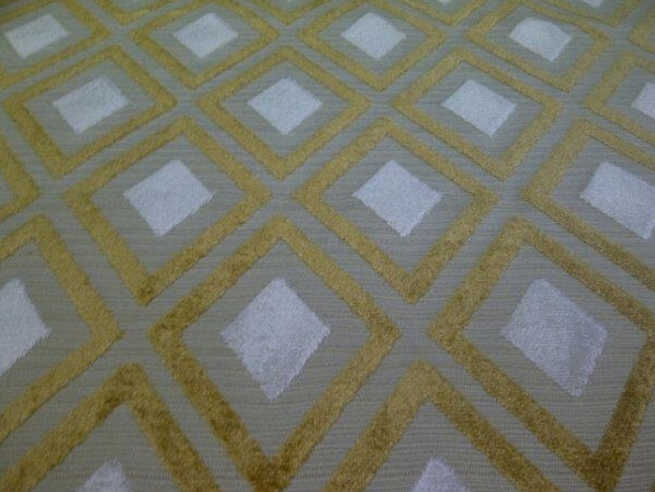 Woven area rug in classy light gray, gold and white diamond print size 4ft by 6ft. $199.95, via Etsy.