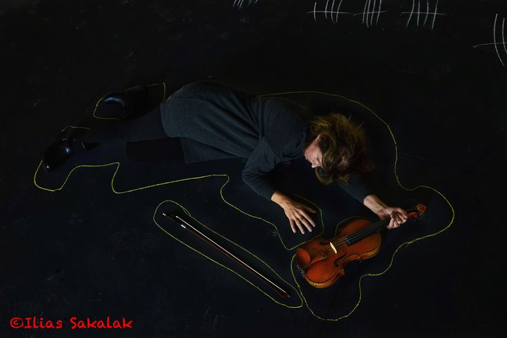 Musician found - A violinist lying on the ground