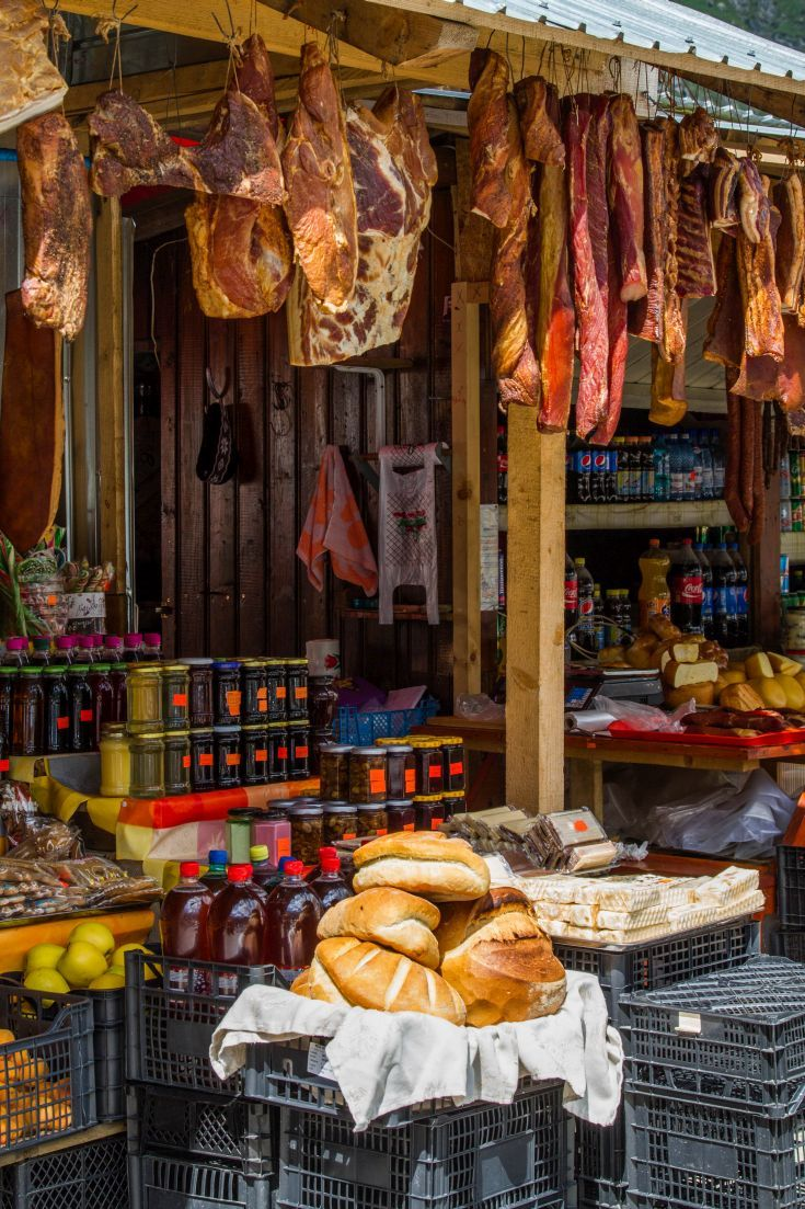 A vendor selling traditional meats, cheese, and other wonderful food items located in the pass of the Transfagarsan Highway.   www.haisitu.ro