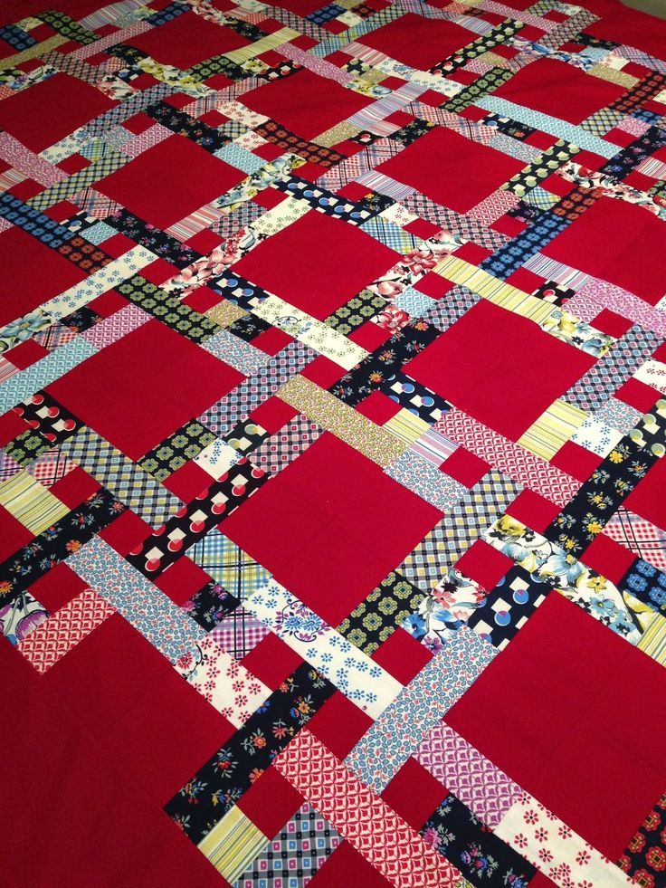 Love The Red as background on this scrappy quilt