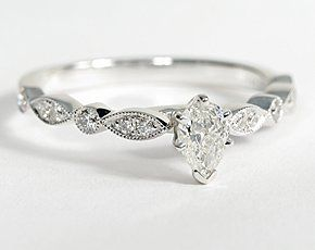 Vintage-inpired, this diamond engagement ring is crafted in 14k white gold and features petite diamonds set in a marquise and dot pattern with milgrain edges to frame your center diamond. Setting includes 1/5 carat total diamond weight.