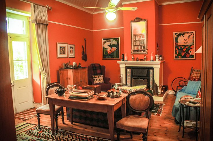 A fireplace which creates a hard-to-describe ambiance in this historical real estate in Paarl, Western Cape.