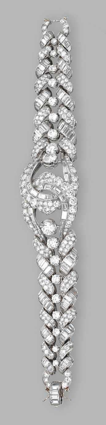 PLATINUM AND DIAMOND BRACELET.  Larger round diamonds weighing approximately 2.35 carats, remaining round and baguette diamonds weighing a total of approximately 33.00 carats, length 7¼ inches.