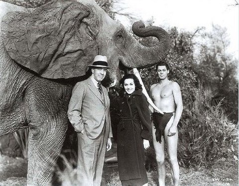 Edgar Rice Burroughs with Johnny Weissmuller and Maureen O'Hara on the set of one of the six Tarzan movies the duo made