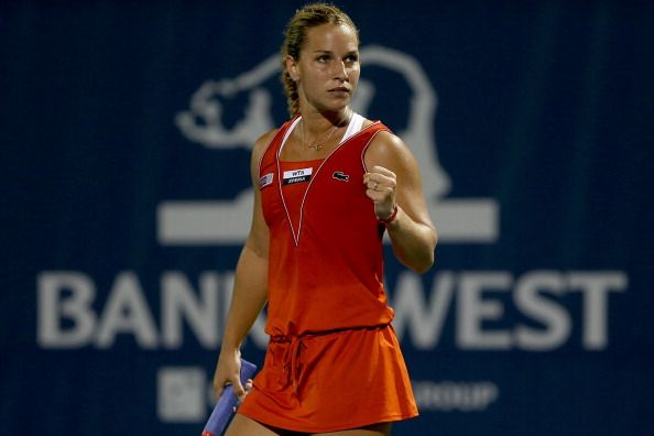 Dominika Cibulkova of Slovakia celebrates winning the first set against Erika Sema of Japan during the Bank of the West Classic at Stanford University Taube Family Tennis Stadium on July 12, 2012 in Stanford, California