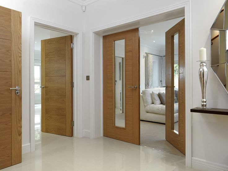 JB Kind's River Oak Tigris and Emral modern style doors.  Beautiful oak flush veneers with grooved panel design. #interiordesign